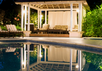 Pool at night with gazebo in background