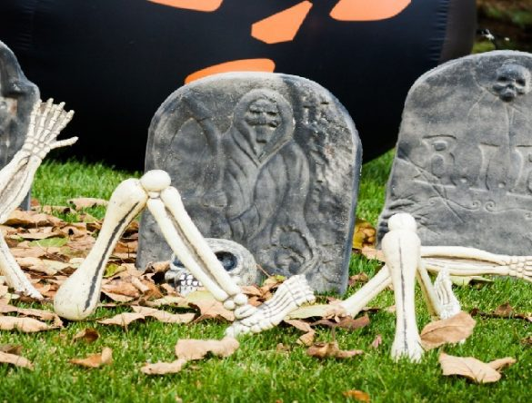 Halloween decorations in the front yard of a house on Halloween.
