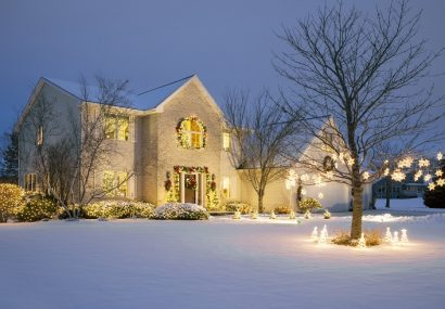 House decorated for Christmas with snow outside