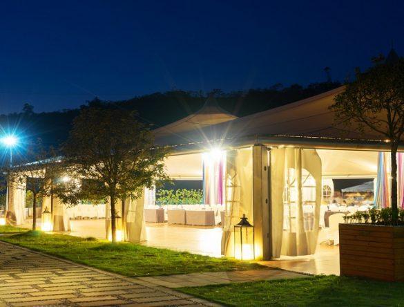 outdoor restaurant under huge tent at night