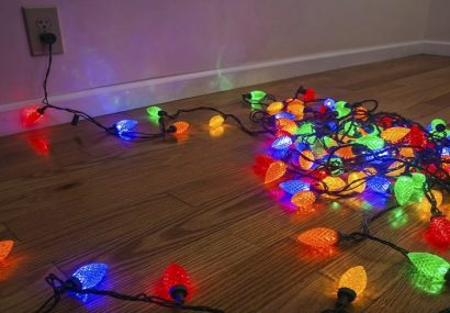 Holiday lights strung out on floor