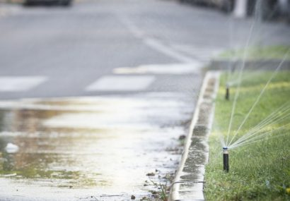 Garden irrigation system oversprays into street