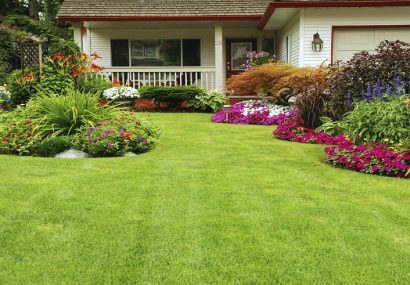 Beautiful lawn with flowerbeds on side